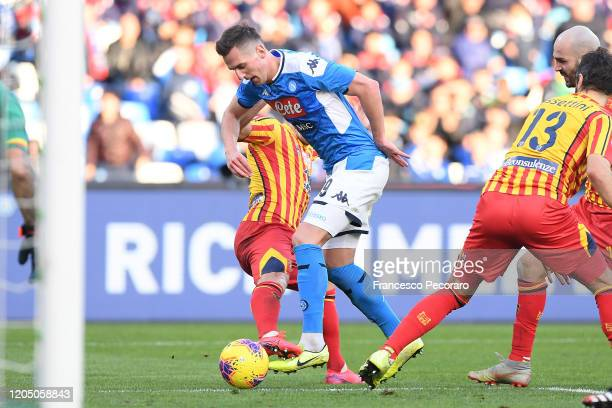 Arkadiusz Milik of SSC Napoli vies with Giulio Donati of US Lecce during the Serie A match between SSC Napoli and US Lecce at Stadio San Paolo on...