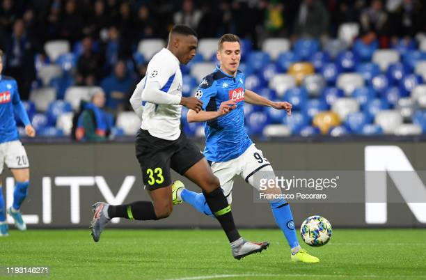 Arkadiusz Milik of SSC Napoli vies with Jhon Lucumi of KRC Genk during the UEFA Champions League group E match between SSC Napoli and KRC Genk at...