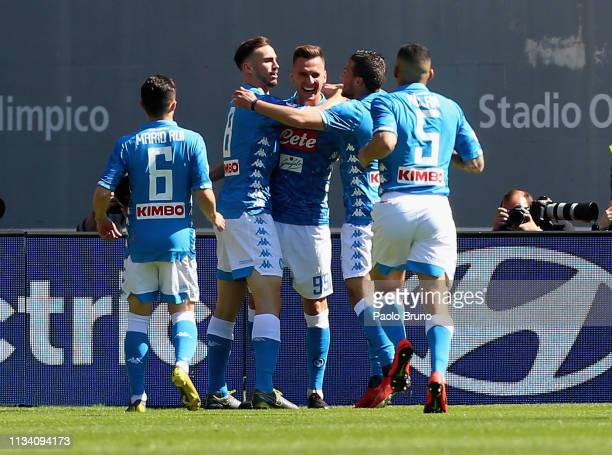 Arkadiusz Milik with his teammates of SSC Napoli celebrates after scoring the opening goal during the Serie A match between AS Roma and SSC Napoli at...