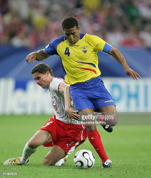 Arkadiusz Radomski of Poland falls over as Ulises De la Cruz of Ecuador gets past him during the FIFA World Cup Germany 2006 Group A match between...