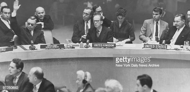 Arkady Sobolev raises his hand to veto resolution by Henry Cabot Lodge Jr with Britain's Sir Pierson Dixon seated between them