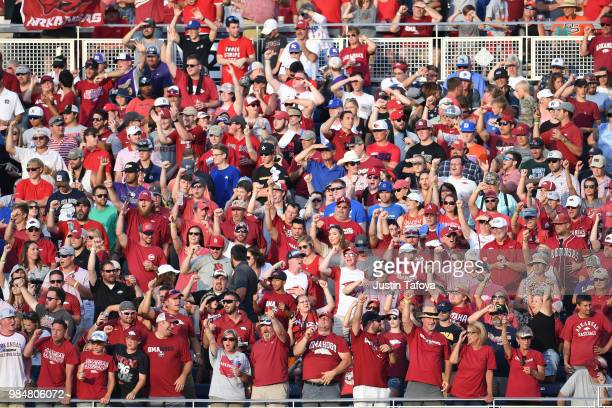 Arkansas fans cheer during the Division I Men's Baseball Championship held at TD Ameritrade Park on June 26 2018 in Omaha Nebraska
