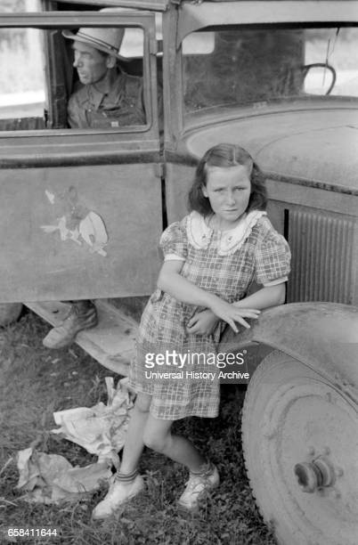 Arkansas Farmer and Daughter now Picking Fruit in Berrien County Michigan USA John Vachon for Farm Security Administration July 1940