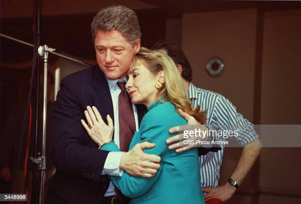 Arkansas Governor Bill Clinton comforts Hillary Rodham Clinton on the set of the news program '60 Minutes' after a stage light unexpectedly broke...