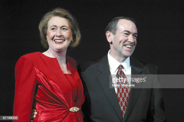 Arkansas Governor Mike Huckabee and his wife Janet smile after converting their 30 year marriage to a covenant marriage before several thousand...