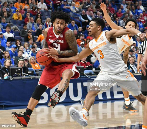 Arkansas guard Anton Beard drives to the basket ahead of Tennessee guard James Daniel III during a Southeastern Conference Basketball Tournament game...