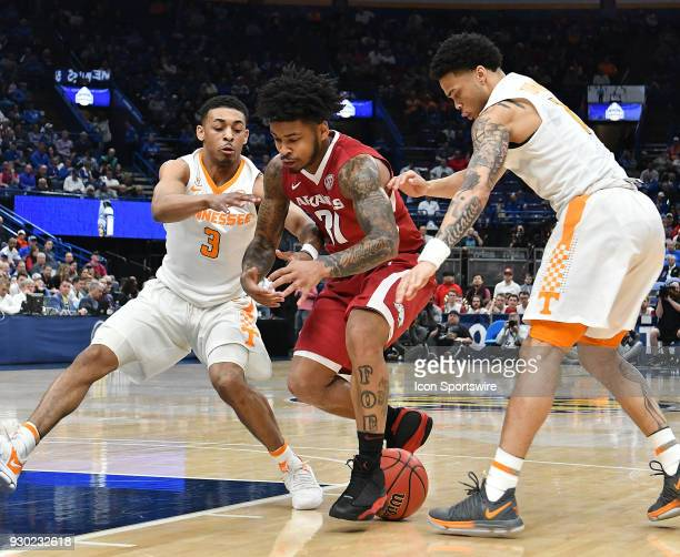 Arkansas guard Anton Beard looses control of the ball while guarded by Tennessee guard James Daniel III during a Southeastern Conference Basketball...