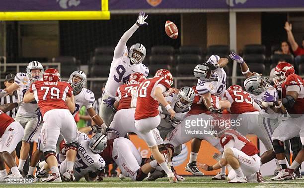 Arkansas kicker Zach Hocker kicks a 30yard field goal for the final points as Arkansas beats Kansas State 2916 in the Cotton Bowlat Cowboys Stadium...