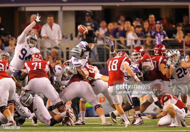 Arkansas kicker Zach Hocker kicks a 30yard field goal for the final points as Arkansas beats Kansas State 2916 in the Cotton Bowlat Cowboys Stadium...