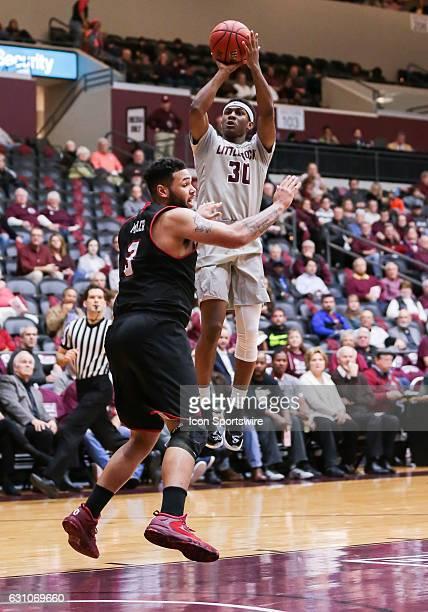Arkansas Little Rock Trojans guard Deondre Burns shoots over Louisiana Lafayette Ragin Cajuns forward Justin Miller during an NCAA basketball game...