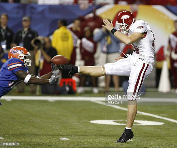 Arkansas punter Jacob Skinner has a punt blocked in the 2nd quarter by Florida WR Jarred Fayson during the SEC Championship game between the Arkansas...