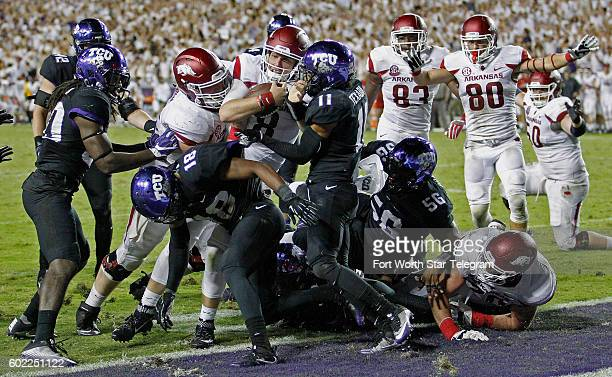 Arkansas quarterback Austin Allen drives into the end zone to score the winning touchdown in double overtime against Texas Christian at Amon G Carter...