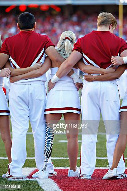 Arkansas Razorback cheerleader Patience Beard who cheers with a prosthetic leg during a game against the Rutgers Scarlet Knights at Razorback Stadium...