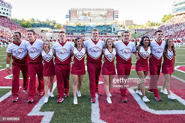 Arkansas Razorback Cheerleaders sing after a game against the Alabama Crimson Tide at Razorback Stadium on October 8 2016 in Fayetteville Arkansas...