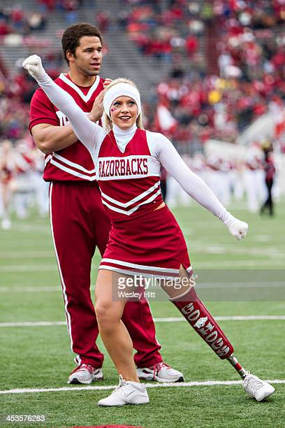 Arkansas Razorbacks cheerleader Patience Beard with her new Go Hogs prosthetic leg performs before a game against the Mississippi State Bulldogs at...