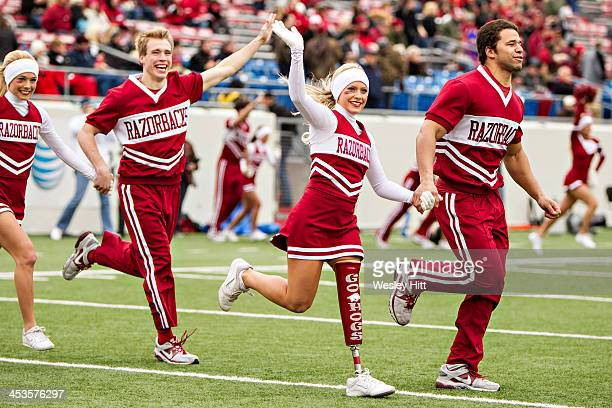 Arkansas Razorbacks cheerleader Patience Beard with her new Go Hogs prosthetic leg runs onto the field before a game against the Mississippi State...