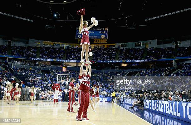 Arkansas Razorbacks cheerleaders performin the game against the Georgia Bulldogs during the SEC Basketball Tournament Semifinals at Bridgestone Arena...
