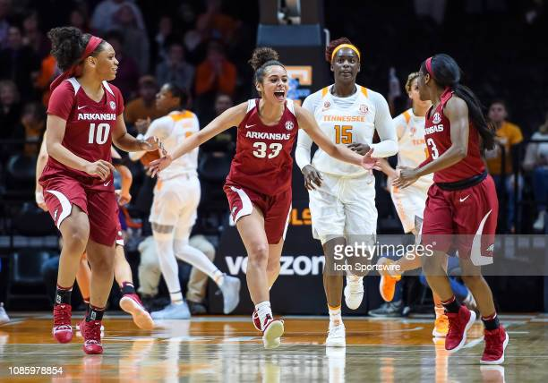 Arkansas Razorbacks guard Chelsea Dungee and forward/center Kiara Williams celebrate with guard Malica Monk after she hits the winning shot during a...