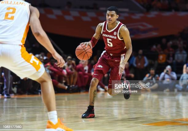 Arkansas Razorbacks guard Jalen Harris brings the ball up court during a college basketball game between the Tennessee Volunteers and Arkansas...
