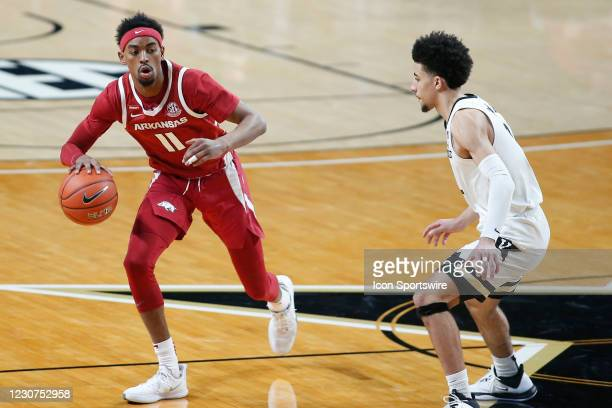 Arkansas Razorbacks guard Jalen Tate brings the ball down as Vanderbilt Commodores guard Scotty Pippen Jr. Defends during a game between the...
