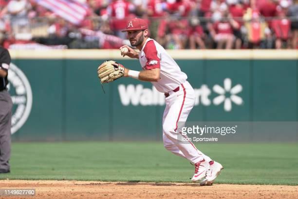 Arkansas Razorbacks infielder Jack Kenley makes a throw to first base during Game 3 of the NCAA Super Regional baseball game between the Arkansas...