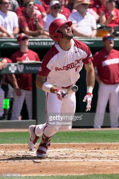 Arkansas Razorbacks infielder Jack Kenley watches a first inning home run clear the fence during the NCAA Super Regional baseball game between the...