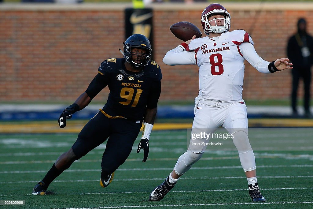 Arkansas Razorbacks quarterback Austin Allen (8) throws a pass while under pressure from Missouri Tigers defensive end Charles Harris (91) during the second half of a NCAA football game on November 25, 2016, at Memorial Stadium in Columbia Missouri.