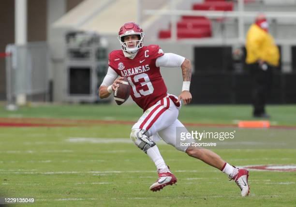 Arkansas Razorbacks quarterback Feleipe Franks scrambles from defenders in the game between the Ole Miss Rebels and the Arkansas Razorbacks on...