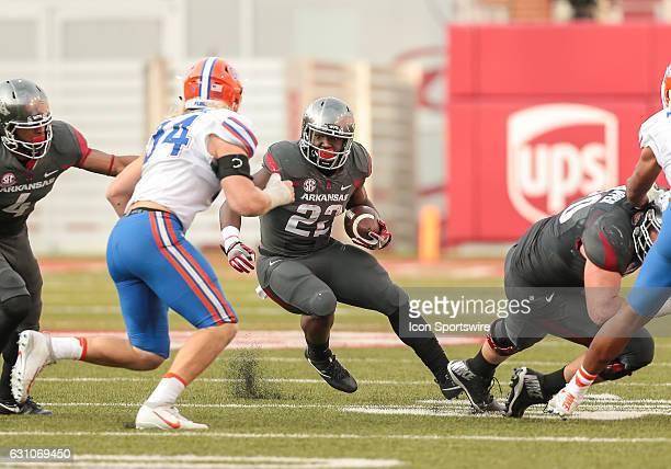 Arkansas Razorbacks running back Rawleigh Williams III looks to run past Florida Gators linebacker Alex Anzalone during an NCAA football game between...