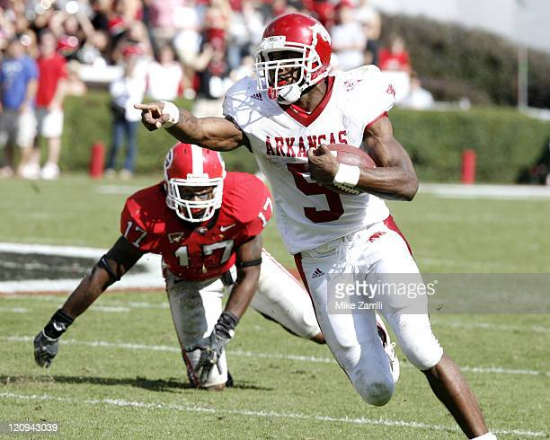 Arkansas running back Darren McFadden directs traffic on his way to rushing for 190 yards and 2 touchdowns against Georgia at Sanford Stadium in...