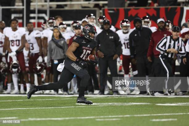 Arkansas State Blake Mack runs with the ball in the game between the Arkansas State University Red Wolves and the Troy Trojans on December 2nd 2017...