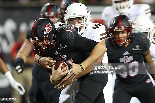 Arkansas State quarterback Justice Hansen fights for extra yards in the game between the Arkansas State Red Wolves and the UL Monroe Warhawks on...