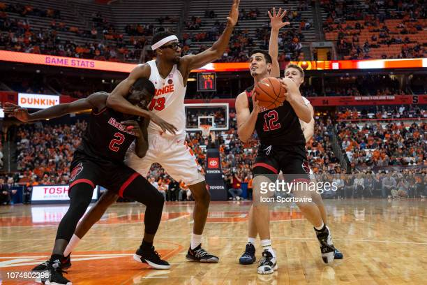 Arkansas State Red Wolves Guard Canberk Kus looks to the basket with Syracuse Orange Center Paschal Chukwu defending and Arkansas State Red Wolves...