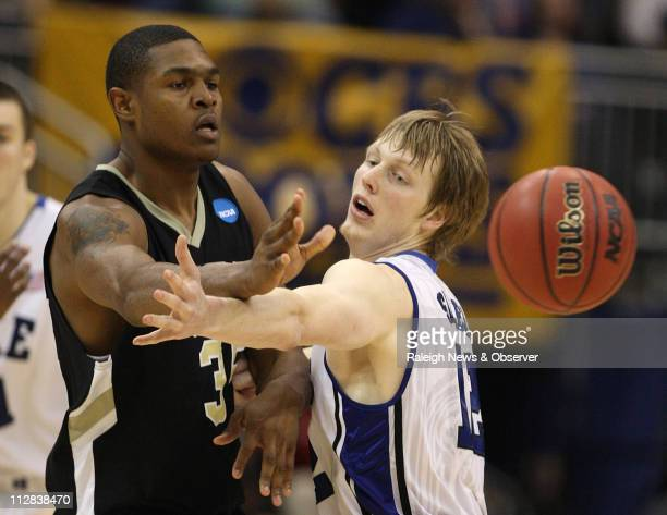 ArkansasPine Bluff's Lebaron Weathers passes the ball as Duke's Kyle Singler defends during game action in the NCAA Men's Basketball Tournament at...