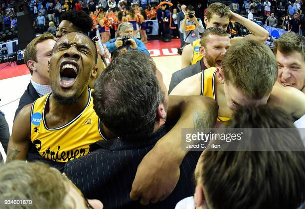 Arkel Lamar of the UMBC Retrievers reacts to their 7454 victory over the Virginia Cavaliers during the first round of the 2018 NCAA Men's Basketball...