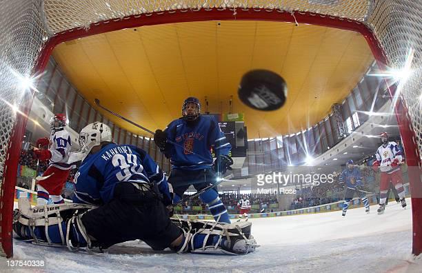 Arkhip Nekolenko of Russia scores his team's opening goal over Kaapo Kahkonen , goaltender of Russia in the Men's Final between Russia and Finland in...