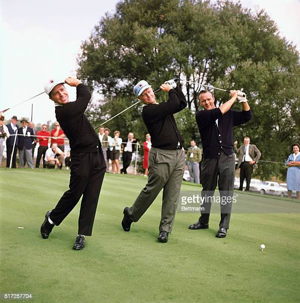 Firestone Country Club big three golfers in the world series of golf Arnold Palmer hatless Jack Nicklaus and Gary Player swing their clubs before a...