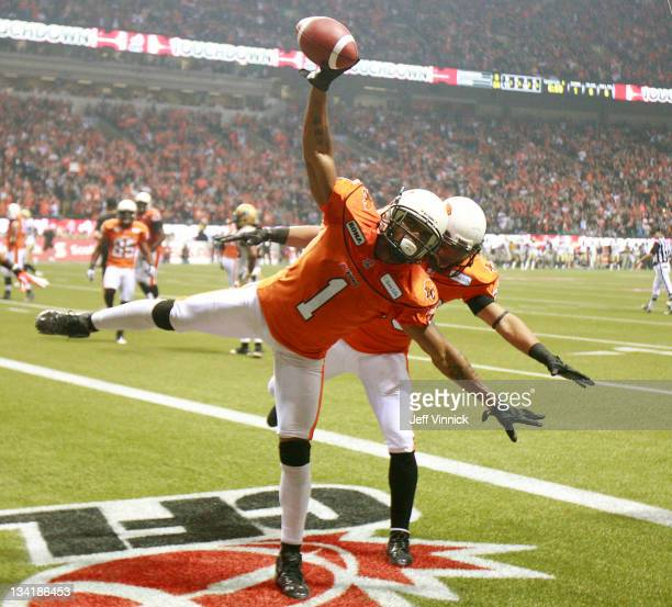 Arland Bruce and Andrew Harris of the BC Lions celebrate fourth-quarter touchdown against the Winnipeg Blue Bombers during the CFL 99th Grey Cup...