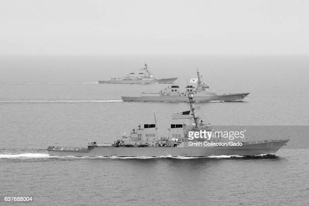 Arleigh Burkeclass guidedmissile destroyer USS John S McCain Republic of Korea Navy Aegisclass destroyer ROKS SeoaeYuSeongRyong and Arleigh...