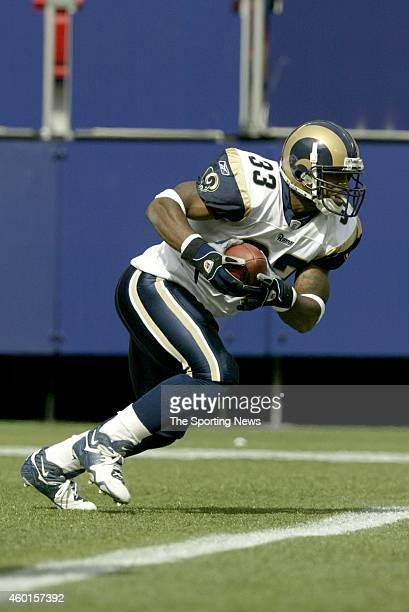 Arlen Harris of the St Louis Rams runs with the ball during a game against the New York Giants on September 07 2003 at the MetLife Stadium in East...