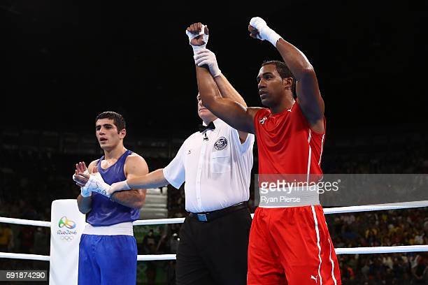 Arlen Lopez of Cuba celebrates after defeating Kamran Shakhsuvarly of Azerbaijan in a Men's Middle Semifinal bout on Day 13 of the 2016 Rio Olympic...