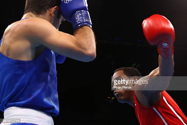 Arlen Lopez of Cuba competes against Kamran Shakhsuvarly of Azerbaijan during a Men's Middle Semifinal bout on Day 13 of the 2016 Rio Olympic Games...