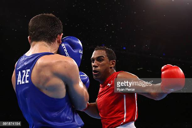 Arlen Lopez of Cuba fights against Kamran Shakhsuvarly of Azerbaijan during a Men's Middle Semifinal bout on Day 13 of the 2016 Rio Olympic Games at...