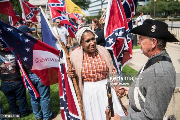 Arlene Barnum of Stewart OK talks with a Confederate flag supporter at the South Carolina Statehouse on July 10 2017 in Columbia South Carolina To...