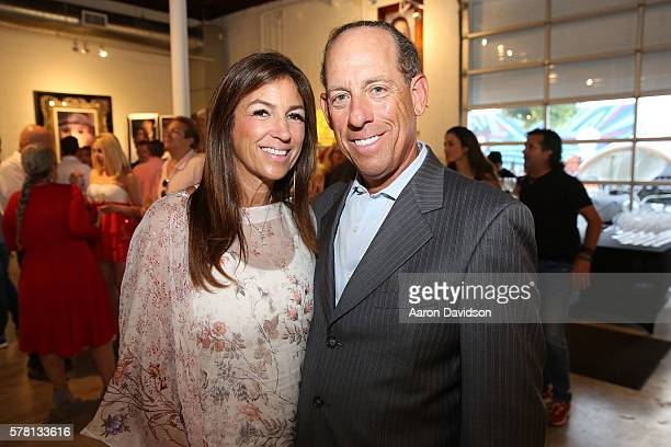 Arlene Chaplin and Wayne Chaplin attend Peter Tunney Ocean Drive Magazine cover debut at Wynwood Walls on July 20 2016 in Miami Florida