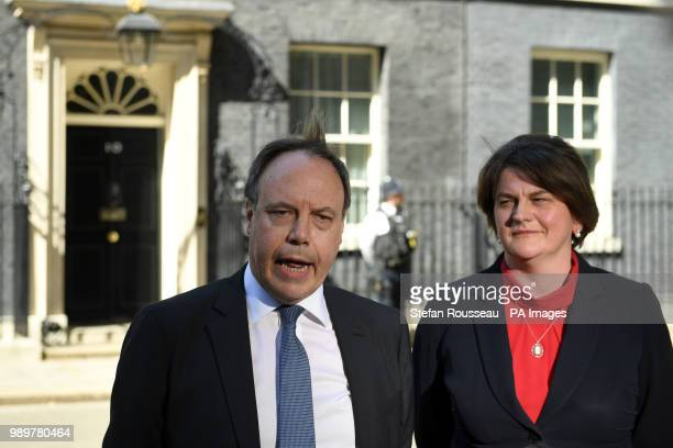 Arlene Foster Leader of the Democratic Unionist Party and the party's deputy leader Nigel Dodds leave Downing Street following a meeting with Prime...