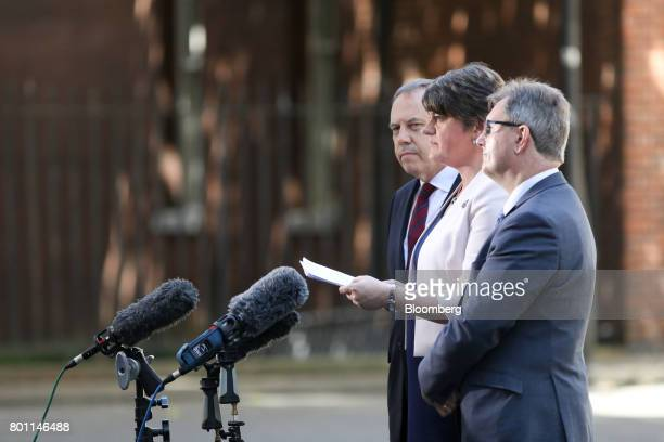 Arlene Foster leader of the Democratic Unionist Party center makes a statement outside number 10 Downing Street as she is flanked by Nigel Dodds...