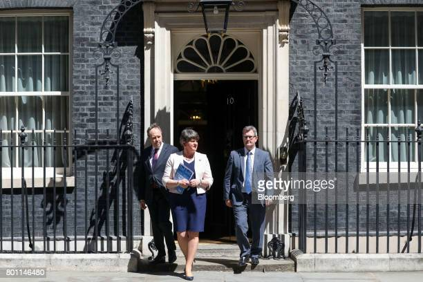 Arlene Foster leader of the Democratic Unionist Party center Nigel Dodds deputy leader of the Democratic Unionist Party left and Jeffrey Donaldson...