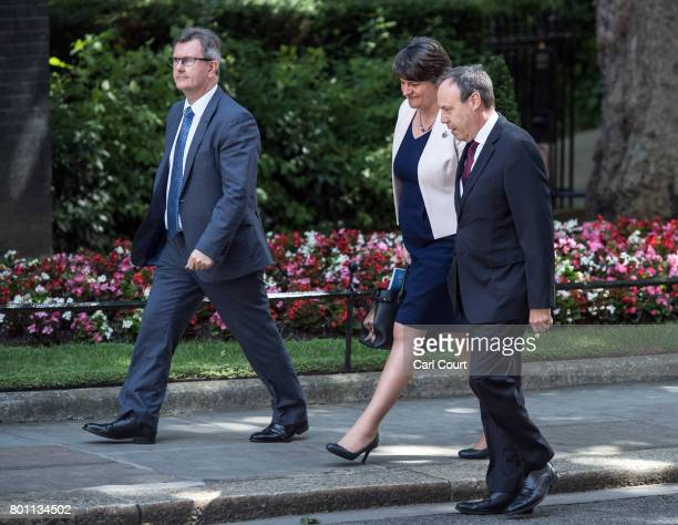 Arlene Foster the leader of Northern Ireland's Democratic Unionist Party deputy leader of the Democratic Unionist Party Nigel Dodds and DUP MP...