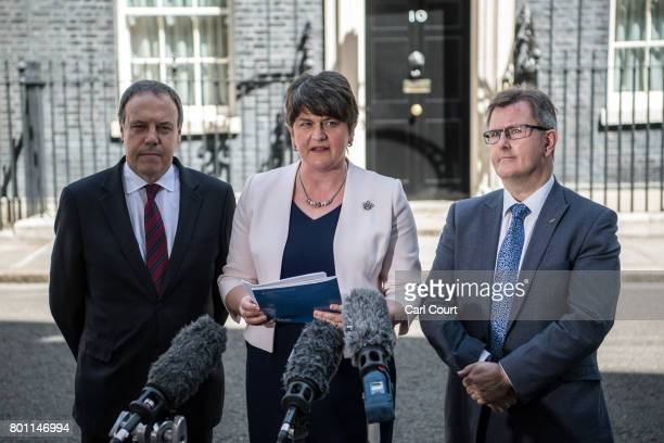 Arlene Foster , the leader of Northern Ireland's Democratic Unionist Party, party deputy leader, Nigel Dodds and MP Jeffrey Donaldson , speak to the...